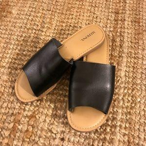 Black faux leather slide-on sandals